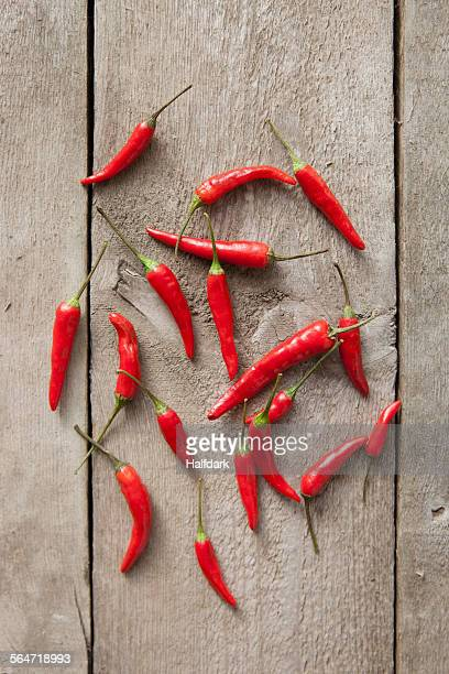 Directly above shot of red chili peppers on wooden table