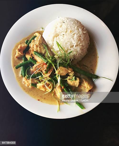 Directly Above Shot Of Rice With Chicken Curry Served On Table
