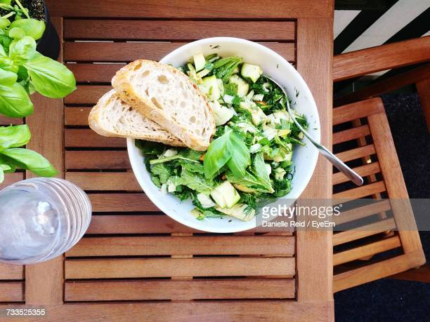 Directly Above Shot Of Salad With Bread On Table
