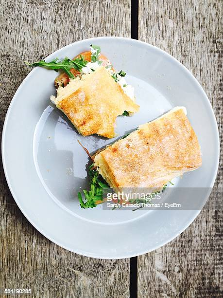 Directly Above Shot Of Sandwiches In Plate On Wooden Floor