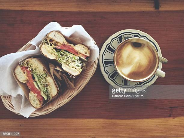 Directly Above Shot Of Serving Sandwich With Coffee On Table