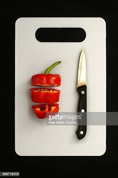 Directly Above Shot Of Slice Red Bell Pepper With Knife On Cutting Board