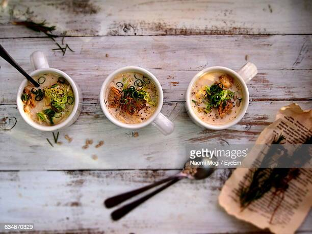 Directly Above Shot Of Soup Served In Container On Wooden Table