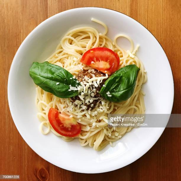 Directly Above Shot Of Spaghetti Served In Plate On Wooden Table