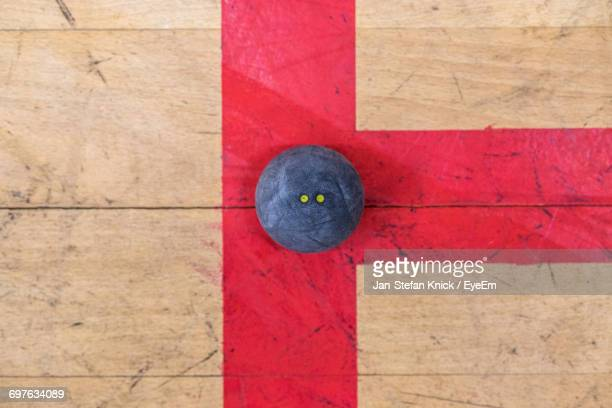Directly Above Shot Of Squash Ball On Court