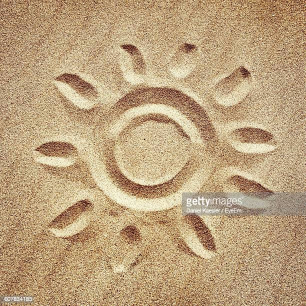 Directly Above Shot Of Sun Drawn On Beach