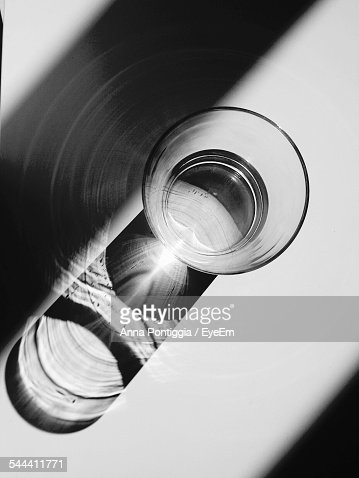 Directly Above Shot Of Sunlight Falling On Drinking Glass