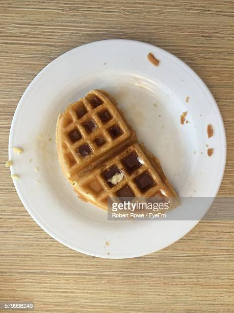 Directly Above Shot Of Syrup On Waffle Served In Plate