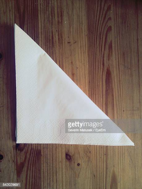 Directly Above Shot Of Tissue Paper On Wooden Table