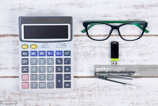 Directly Above Shot Of Usb Stick With Eyeglasses And Stationary On White Table