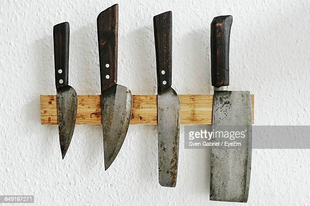 Directly Above Shot Of Various Knives On Wood