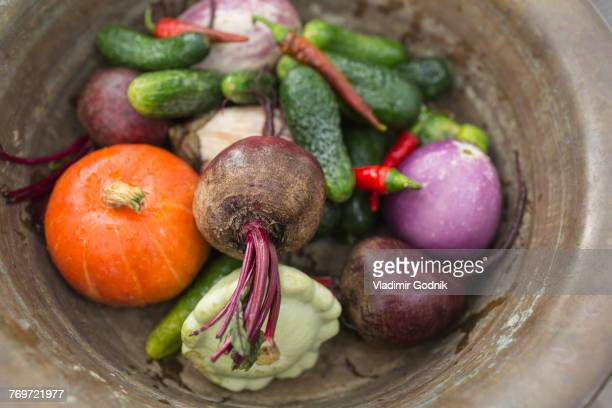 Directly above shot of various vegetables in container on table
