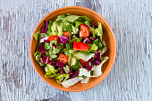 Directly Above Shot Of Vegetable Salad In Bowl On Wooden Table