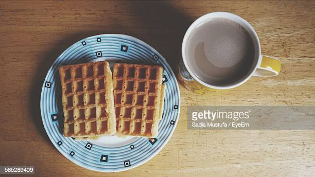 Directly Above Shot Of Waffles And Coffee On Table