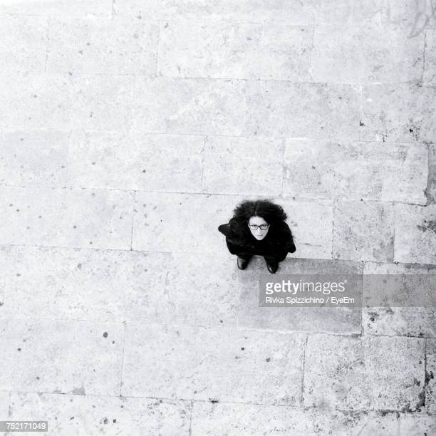 Directly Above Shot Of Woman Standing On Footpath