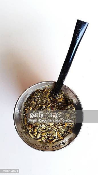 Directly Above Shot Of Yerba Mate In Container On White Background