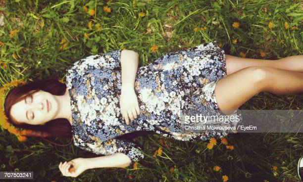 Directly Above Shot Of Young Woman Resting On Grass At Park