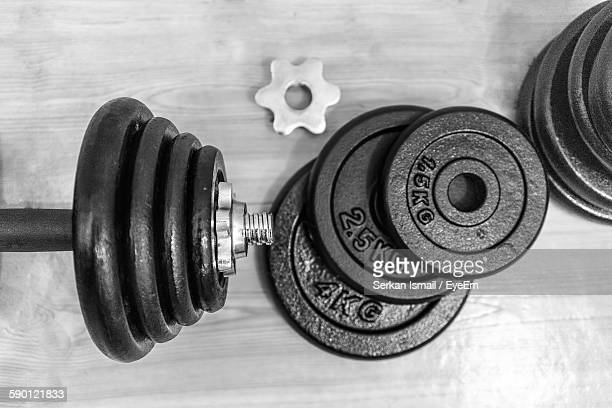 Directly Above View Of Barbell On Hardwood Floor