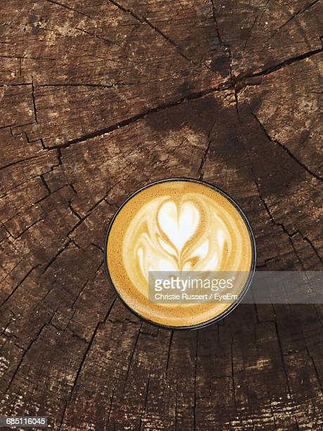 Directly Above View Of Cappuccino With Froth Art On Wooden Table