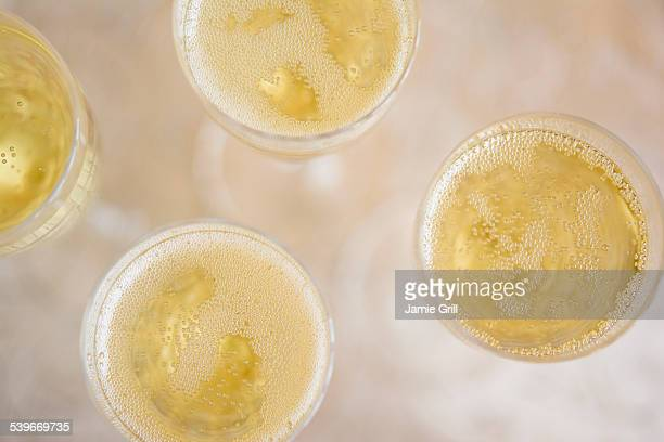 Directly above view of champagne flutes