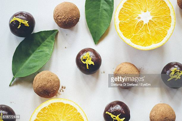 Directly Above View Of Chocolate Truffles And Oranges