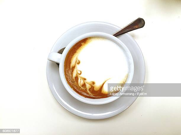 Directly Above View Of Coffee Against White Background