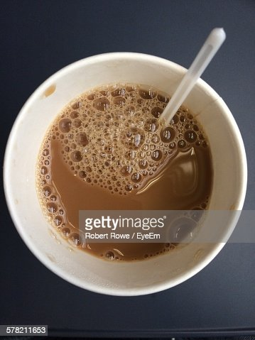 Directly Above View Of Coffee In Disposable Cup On Table