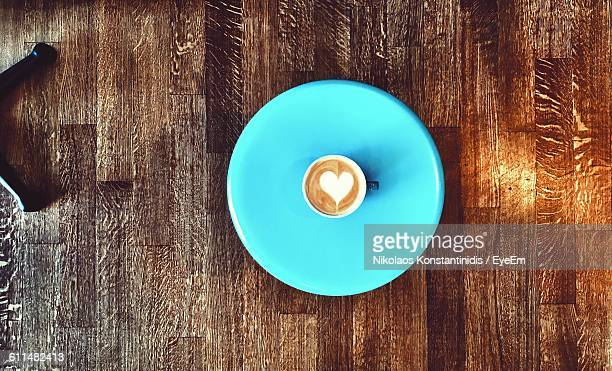 Directly Above View Of Coffee With Heart Shape Froth Served In Plate