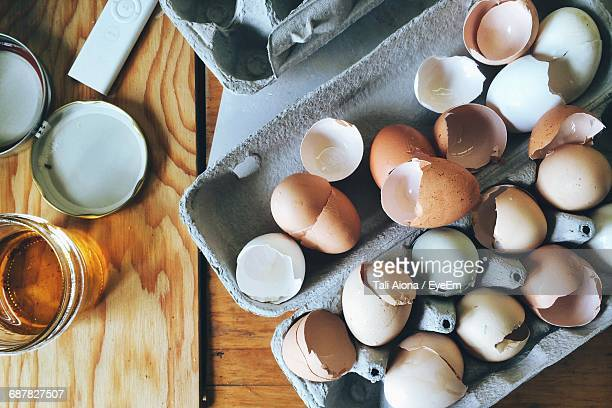Directly Above View Of Eggshells In Carton On Table