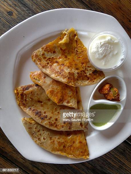 Directly Above View Of Fresh Paratha Served In Plate On Table
