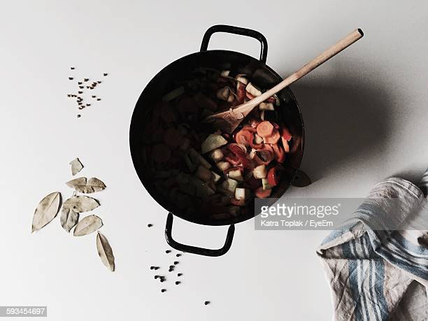 Directly Above View Of Fresh Vegetables In Cooking Pan On White Background