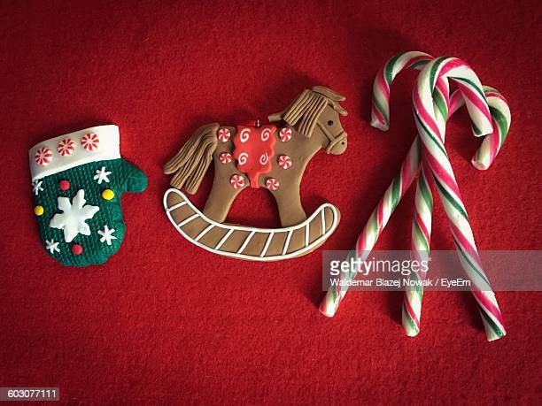 Directly Above View Of Horse Shaped Chocolate With Candy Canes On Carpet