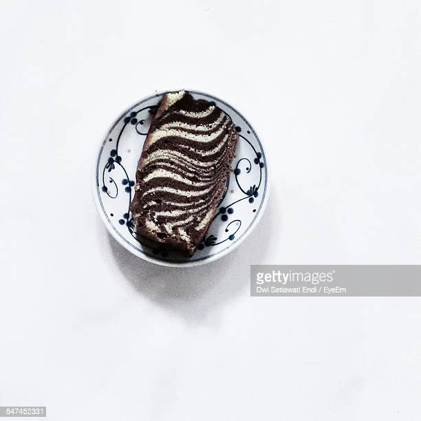 Directly Above View Of Marble Cake In Plate Over White Background