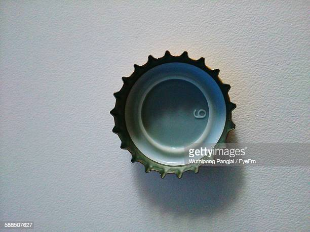 Directly Above View Of Metallic Cap On White Floor