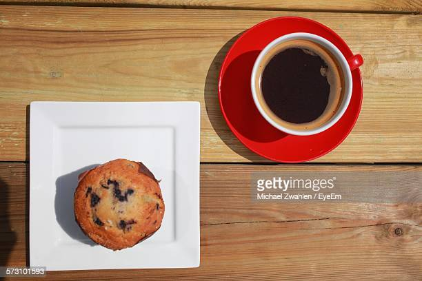 Directly Above View Of Muffin And Black Coffee On Table