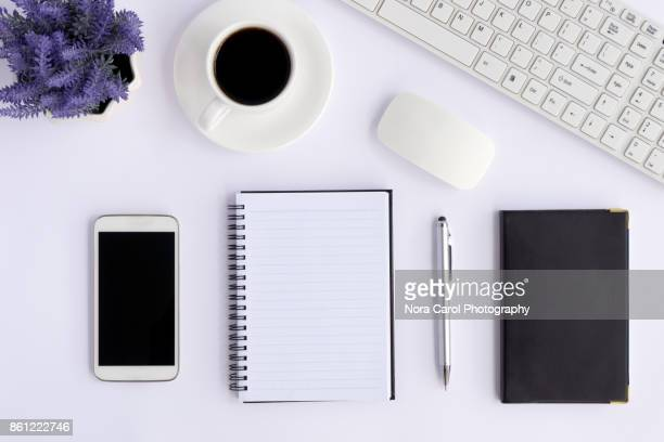 Directly Above View of Office Desk on White Background