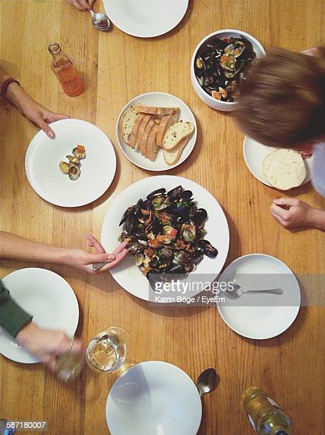 Directly Above View Of People Having Oysters On Dining Table