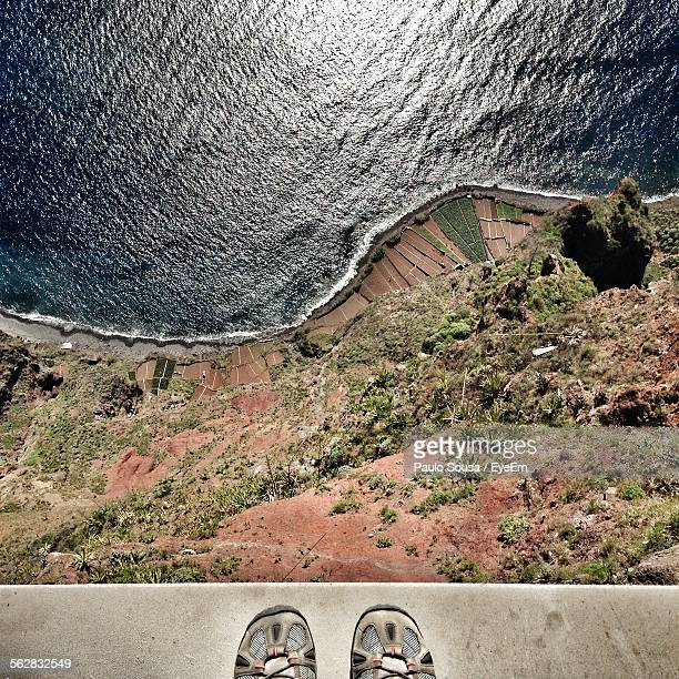 Directly Above View Of Person Shoes At Edge Of Cliff On Madeira Island