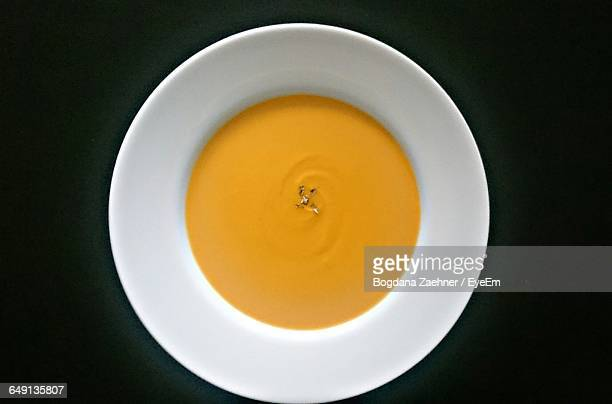 Directly Above View Of Pumpkin Soup Served In Bowl On Black Background