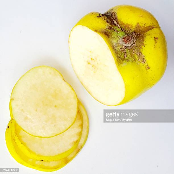 Directly Above View Of Quince Against White Background