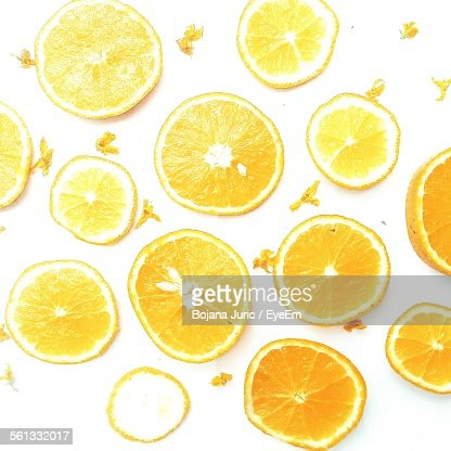 Directly Above View Of Slices Of Orange Against White Background