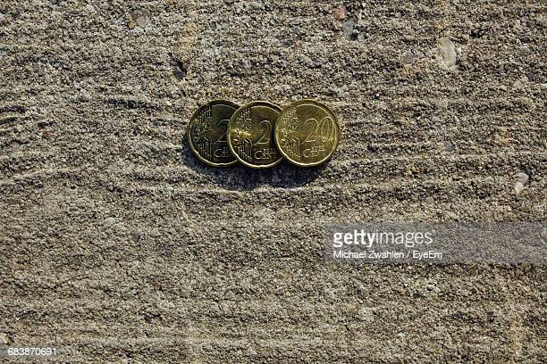 Directly Above View Of Twenty Euro Cents On Concrete