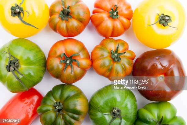 Directly Above View Of Various Tomatoes On White Background