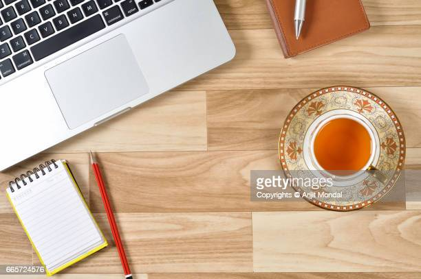 Directly Above View Office Stuff On Desk Workplace with Laptop, Green Tea Cup Plate, Notepad, Retro Style