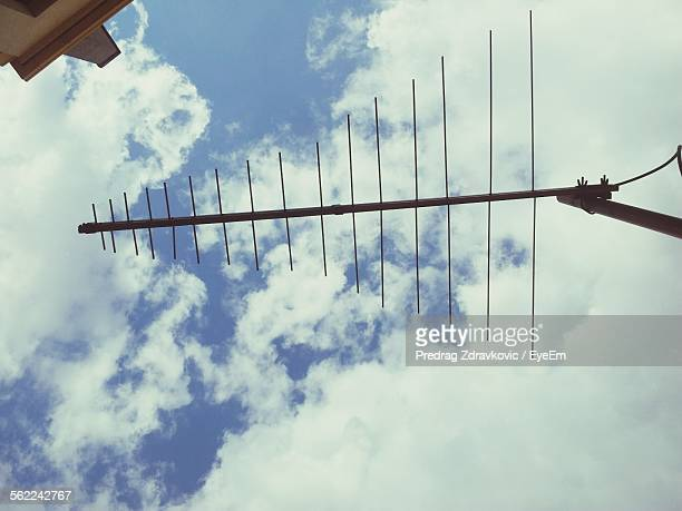 Directly Below Shot Of Antenna Against Cloudy Sky
