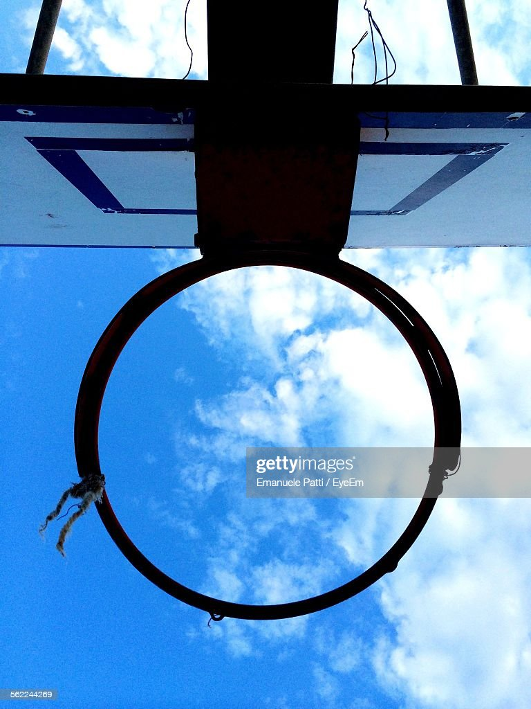 directly below shot of basketball goal ring against sky stock