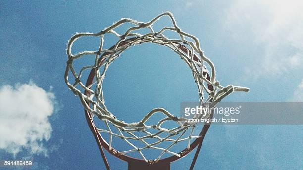 Directly Below Shot Of Basketball Hoop Against Sky