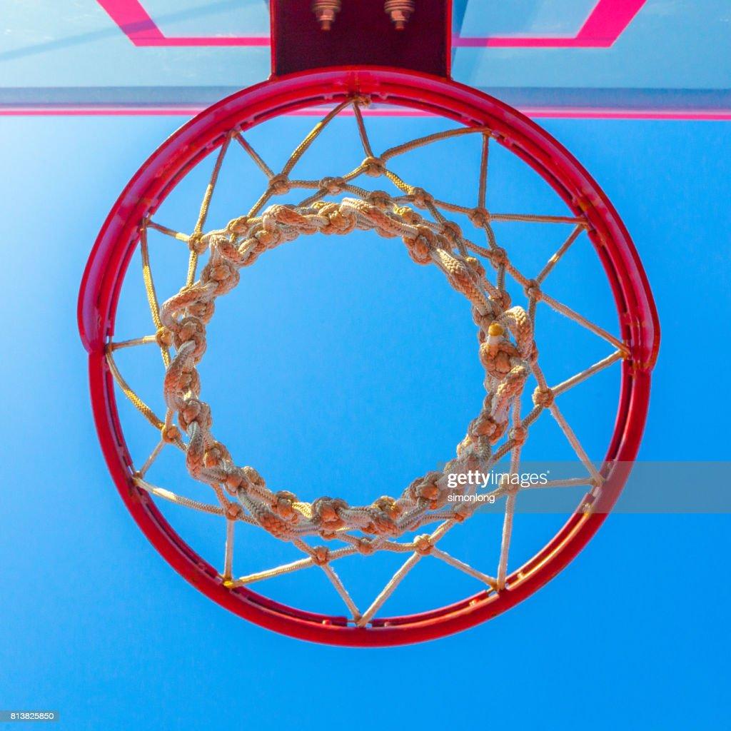 directly below shot of basketball hoop against sky stock photo