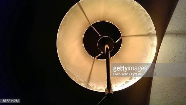 Directly Below Shot Of Lit Lamp On Ceiling