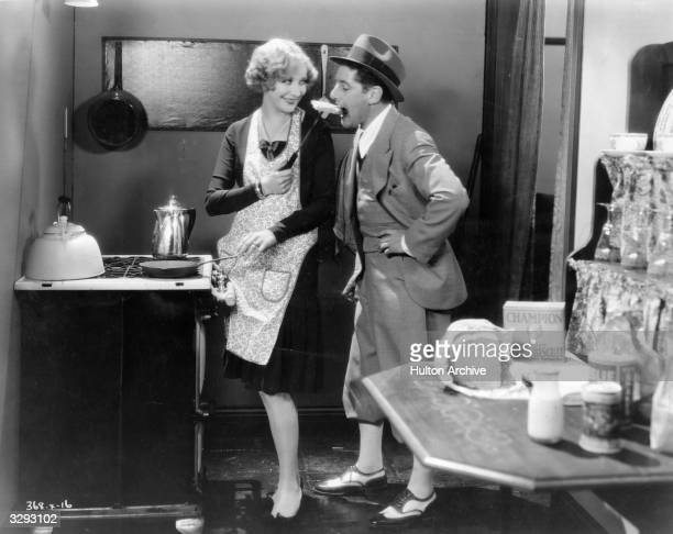 Director A Edward Sutherland jokes around with actress Gwen Lee on the set of the MGM silent comedy 'The Baby Cyclone'
